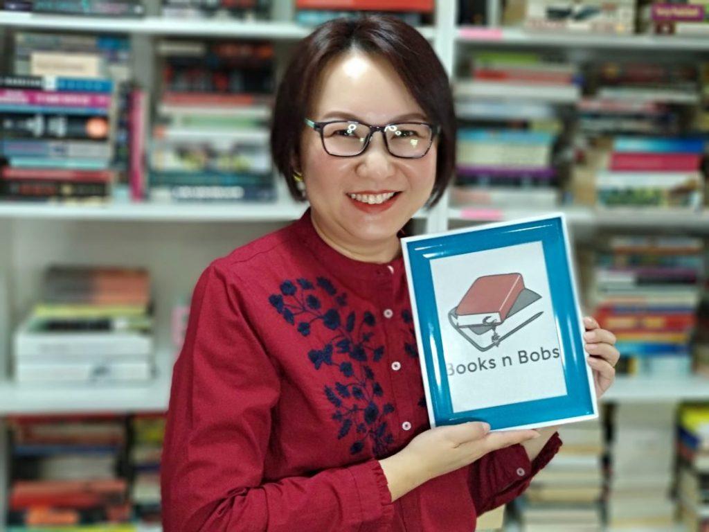 Books Rachel Ang holding BnB frame 2